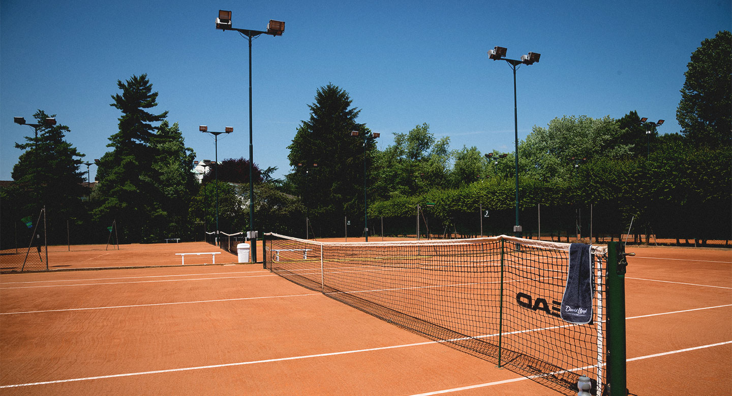 Outdoor clay tennis courts at David Lloyd Malaspina